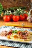 Pasta with octopus, tomatoes and carrots Stock Photography