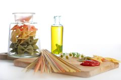 Pasta with oil bottle and ketchup Royalty Free Stock Image