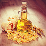 Pasta and oil in a glass. Vintage retro hipster style version Stock Images