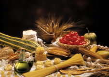 Pasta and oil. Still life on the table of food,shot in studio in Italy year 2003, grain end brown background blur royalty free stock photography