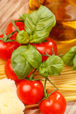 Pasta, olive oil and tomatoes Royalty Free Stock Photo