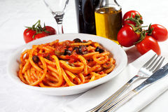 Pasta with olives, bacon and sauce Stock Image