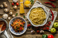 Pasta with olives, tomatoes and basil Royalty Free Stock Images