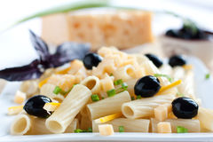 Pasta with onions and cheese. On the background of the ingredients Stock Photography