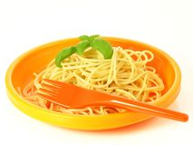 Pasta in orange bowl, isolated Stock Photo