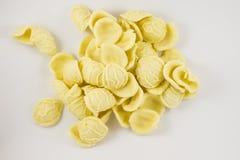 Pasta orecchiette. Tipical italian pasta, orecchiette from puglia, uncooked, on white background Stock Image