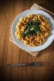 Pasta orecchiette and vegetable on a wooden table Royalty Free Stock Images