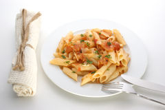 Pasta with organic tomato on a plate Stock Photo