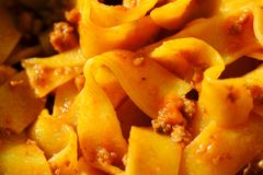 Pasta, Pappardelle, Bolognese, meat. Close up large and sharp photo of a popular all over the world dish - tasty Pappardelle pasta with tomato sauce, stuffed Stock Photos