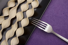 Pasta pappardelle curly and fork Royalty Free Stock Image