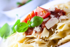 Pasta with parmesan and tomato sauce Royalty Free Stock Photos