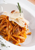 Pasta with parmesan. On white plate Royalty Free Stock Images