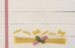 Pasta Pasta. Several pasta on a white wood background with space for a message Stock Photos