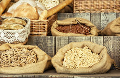 Pasta and pastries in bags on the wooden retro board Royalty Free Stock Images