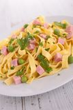 Pasta with pea and ham Stock Photos