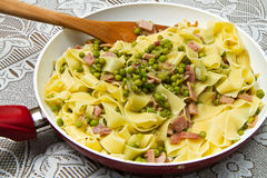 Pasta with peas Stock Photos