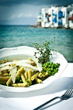 Pasta with peas and thyme. Pasta with peas, thyme and Parmesan cheese by the sea in Mykonos, Greece Royalty Free Stock Images