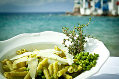 Pasta with peas and thyme by the beach. Pasta with peas and thyme by the beach, Mykonos, Greece Stock Photo