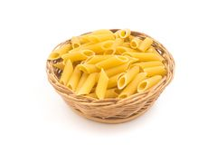 Pasta Penne in a basket bowl stock photography