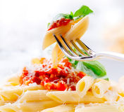 Pasta Penne with Bolognese sauce stock images