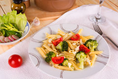 Pasta penne with broccoli, tomatoes and mozzarella Stock Images