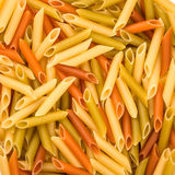 Pasta Penne colorata texture background Stock Photography