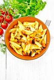 Pasta penne with eggplant and tomatoes on board top royalty free stock photos