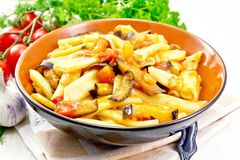 Pasta penne with eggplant and tomatoes on table royalty free stock photography