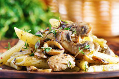 Pasta penne with grilled mushrooms Stock Photo