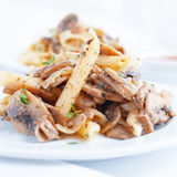 Pasta penne with grilled mushrooms Stock Image