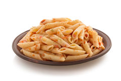 Pasta Penne in plate on white Royalty Free Stock Photography