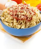 Pasta Penne in plate on white background Royalty Free Stock Photo