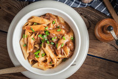 Pasta penne with pork sauce. Royalty Free Stock Photo