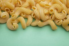 Pasta penne rigate on blue background Royalty Free Stock Photos