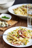 Pasta of Penne rigate, celery and smoked sausage Royalty Free Stock Photos