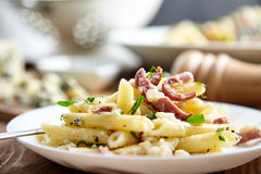Pasta of Penne rigate, celery and smoked sausage Stock Image