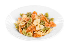 Pasta penne rigate on a plate. Royalty Free Stock Photos