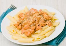 Pasta penne with salmon royalty free stock image