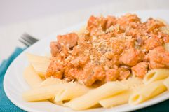 Pasta penne with salmon Stock Photo