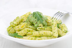 Pasta penne with sauce of arugula and peas on a plate Royalty Free Stock Photography