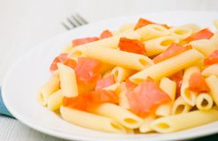 Pasta penne with smoked salmon Royalty Free Stock Photos