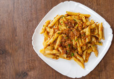 Pasta penne with stew meat sauce Royalty Free Stock Image