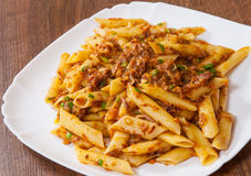 Pasta penne with stew meat sauce Stock Photos