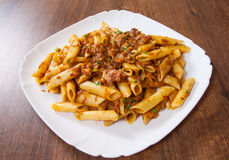 Pasta penne with stew meat sauce Royalty Free Stock Photo