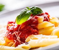 Pasta Penne with Tomato Bolognese Sauce, Parmesan Cheese and Basil on a Fork. Mediterranean food.Italian cuisine Stock Photography