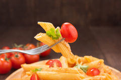 Pasta penne with tomato sauce, Italian food Stock Photos
