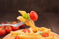Pasta penne with tomato sauce, Italian food Stock Photos