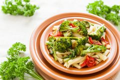 Pasta with pepper and broccoli closeup. Selective focus Stock Photo