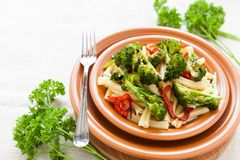 Pasta with pepper and broccoli on a plate closeup Royalty Free Stock Photos