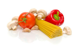 Pasta, peppers, tomatoes, garlic and mushrooms Stock Photography